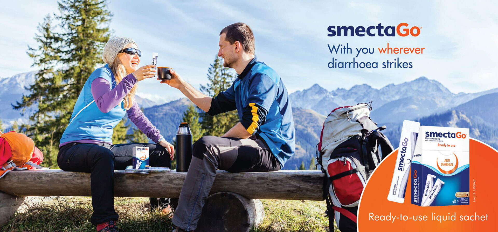 A lady holding a sachet of SmectaGo while the guy is holding a cup of coffee at a camping site.